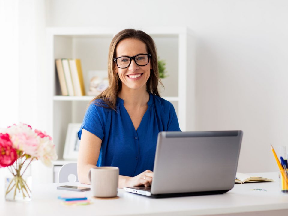a businesswoman working from a brightly lit home office