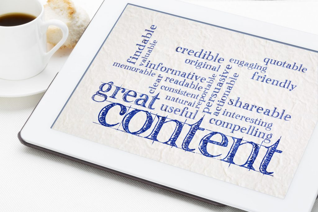 a content marketing word cloud on a table next to a cup of coffee and pastry