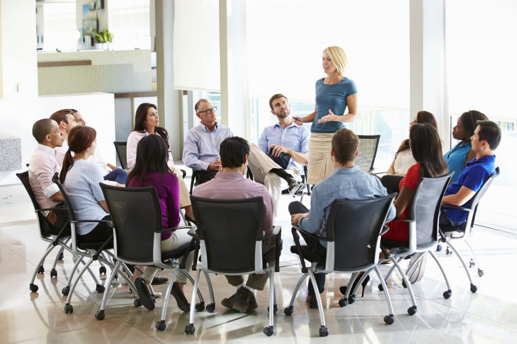 businesswoman discussing the company's mission with her team