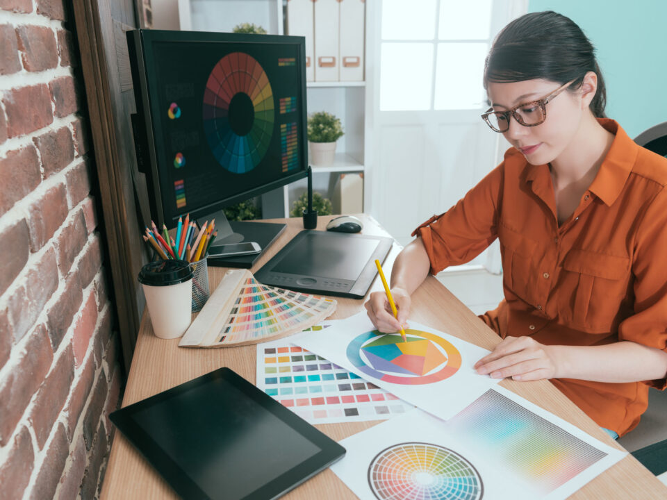 a graphic designer working on her brand's color palette