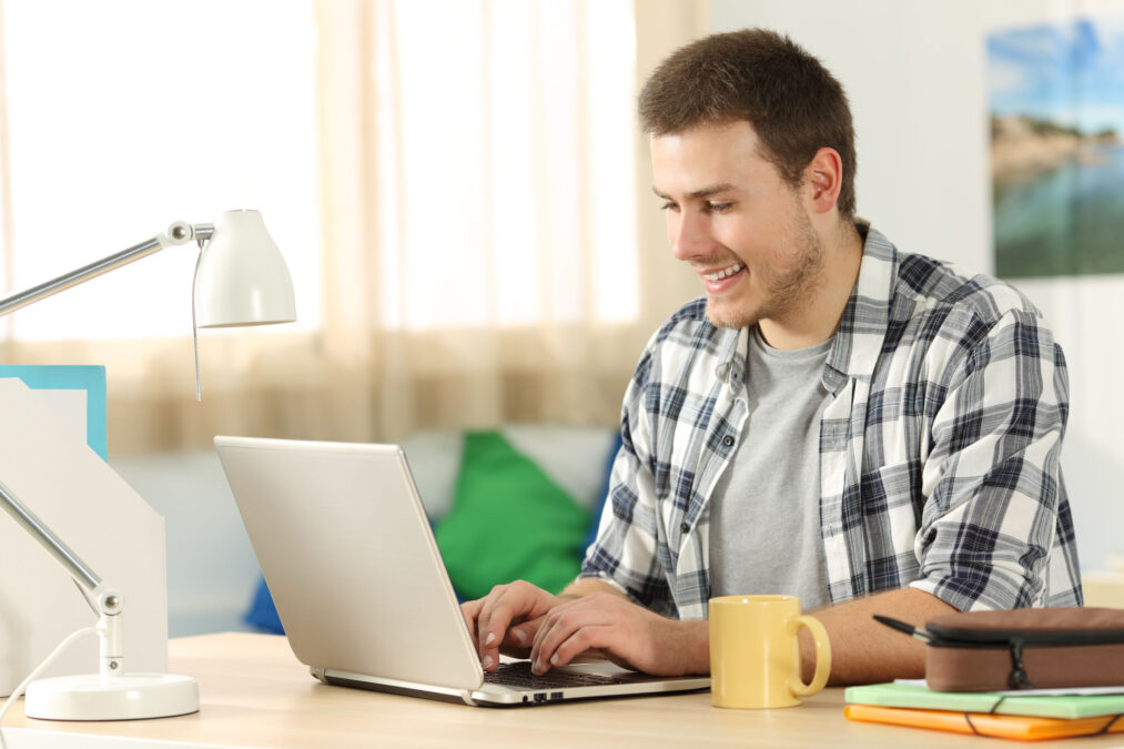 a man seeing an ad on his laptop while working from home