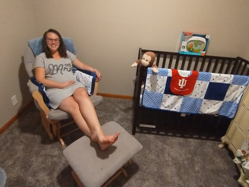 Alaina the mom-to-be in the nursery
